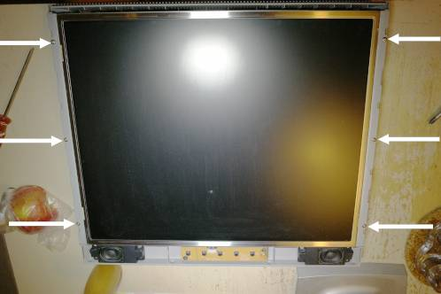 Medion 30919 PO TFT monitor with the bezel removed showing the screws (marked) that hold the LCD panel
